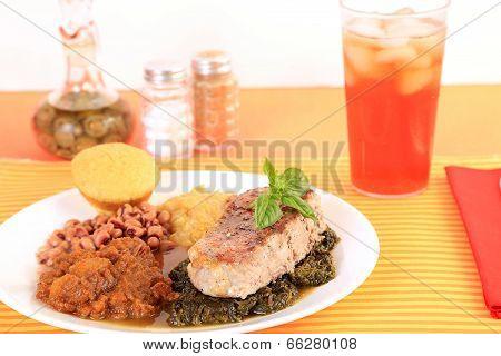 Pork Chop And Collard Greens