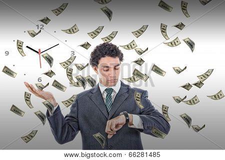 Businessman Looking At His Watch With Money Rain Around Him