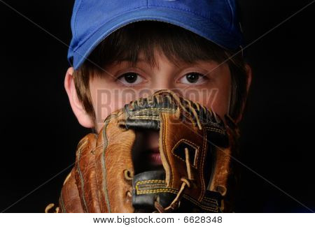 Young pitcher looks in for signs