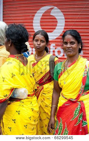 Indian Women In Colorful Sari At Crowded Of Indian City