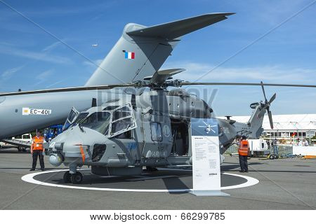 BERLIN, GERMANY - MAY 20, 2014: Multi-role military helicopter NH90 for Army use and the naval NATO Frigate Helicopter (NFH), demonstration during Aerospace Exhibition ILA Berlin Air Show.