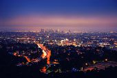 Los Angeles skyline at night, view from Hollywood Hills towards 101 freeway and downtown. poster