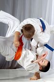 Training judo throw sportsman in judogi and with blue belt poster