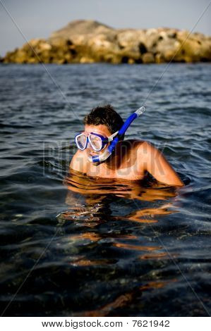 Young Happy Handsome Summer Diving Man With Swimming Mask And Snorkel Preparing To Dive In Blue Sea
