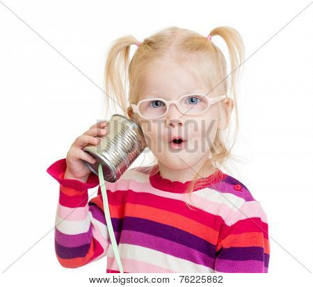 Funny child in eyeglasses using a can as a telephone isolated on white