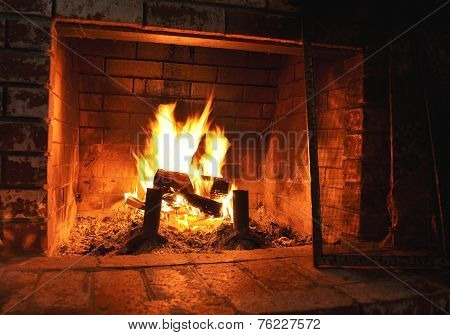 Fireplace with old brick background