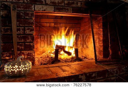 Indoor fireplace with fall decor