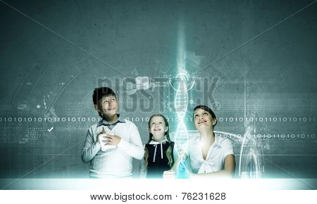 Young teacher and school children at chemistry lesson