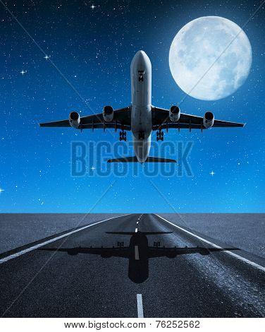 Landing passenger airplane in night.