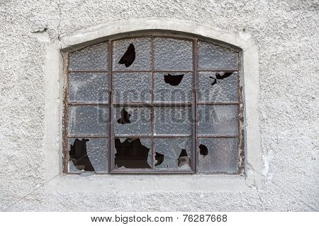 Old window with broken glass in rural Germany