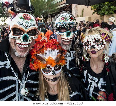 People In Dia De Los Muertos Masks And Makeup