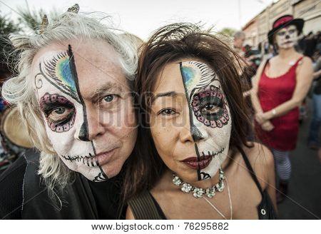 Couple On Dia De Los Muertos In Makeup