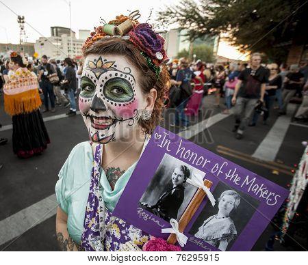 Woman With Sign In Dia De Los Muertos Makeup