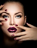 Fashion model girl face, beauty woman make up and manicure. Makeup closeup, perfect skin, manicured nails, deep violet color. Smoky eyes holiday luxury make-up, blue eyes  poster