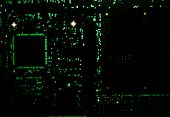 Backlit circuit board showing the various through-board solder points. poster