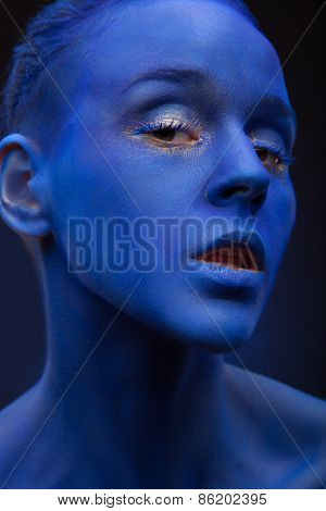 art photo of a beautiful woman with dark blue face