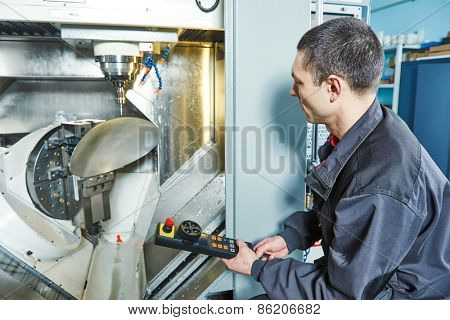 manufacture worker operating machine tool at metal processing factory