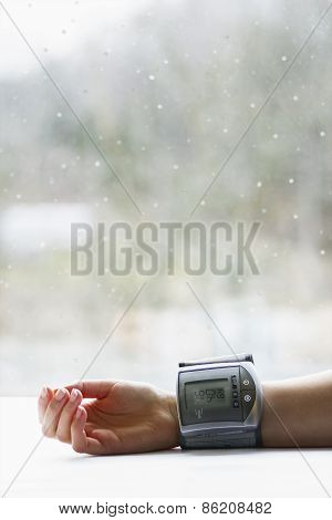 Woman's Hand With Blood Pressure Measuring Device