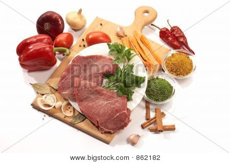 foodstuff: meat and vegetables on the wood board poster