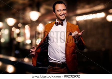 Sharp dressed fashionist fooling around in elite night club