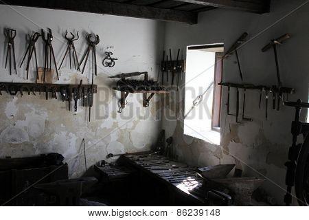 KUMROVEC, CROATIA - SEPTEMBER 24: blacksmith's workshop in Ethnological Folk Museum Staro Selo in Kumrovec, Northern County of Zagorje Croatia on September 24, 2013.