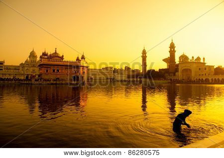 Sunset at Golden Temple in Amritsar, Punjab, India.