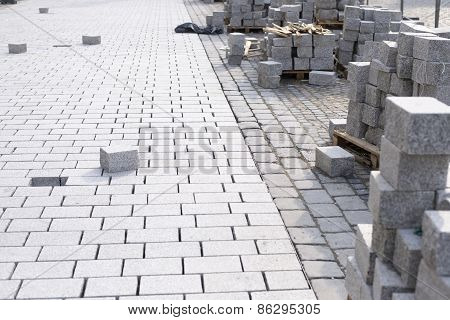 gray Pavement with cobblestones, under construction theme poster