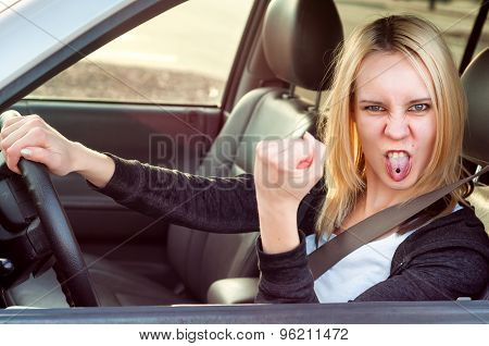 Angry pissed off aggressive student girl driving car poster
