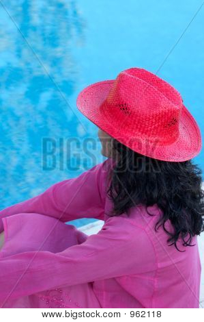 Girl Watching The Water Of The Swimming Pool