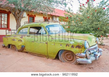 Namibia - May 1, 2015: Old rusty car in front of the building in southern Namibia.