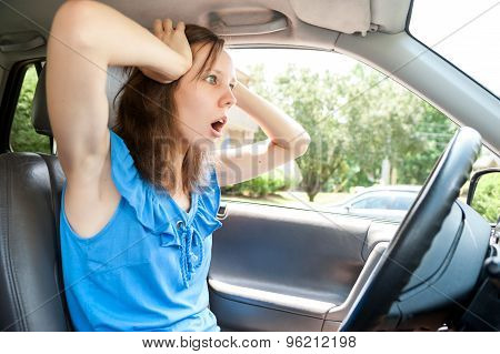 Scared young student girl panic in a car