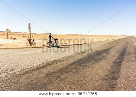 Vioolsdrif, South Africa - May 3, 2015: Cyclist at the stop sign at N7 road near Vioolsdrif in South Africa