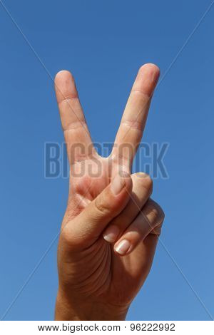 hand showing two fingersWith Sky At Background