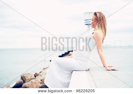 Pregnant Young Woman Relaxing At The Seaside