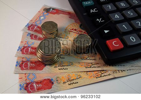 Close up of  Various currency notes and coins from United Arab Emirates poster
