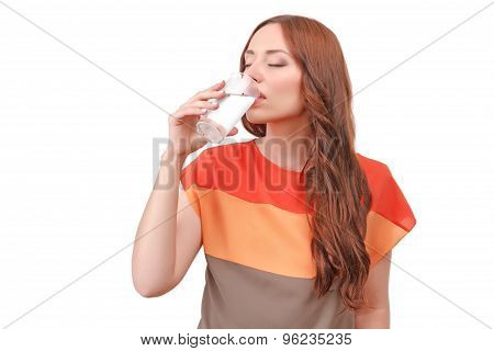 Beautiful red-haired woman drinking water
