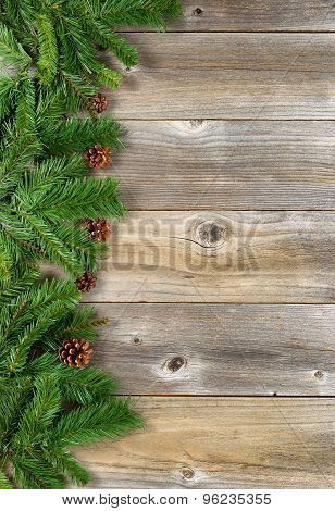 Christmas Border With Evergreen Branches On Rustic Wooden Boards