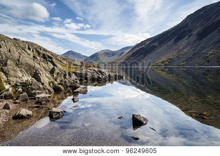 Stunning landscape of Wast Water and Lake District Peaks on Summer day reflected in perfect lake poster
