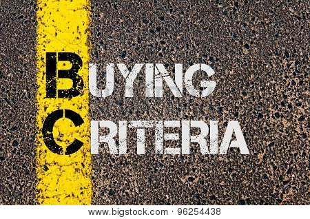 Concept image of Business Acronym BC as Buying Criteria written over road marking yellow paint line. poster