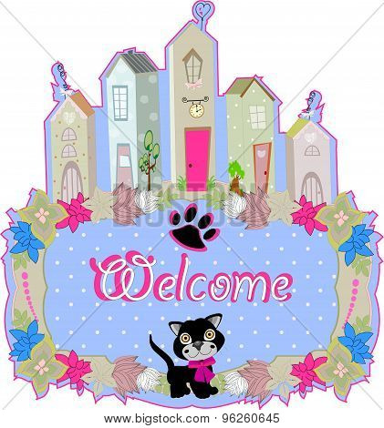 baby cat hold a welcome sign