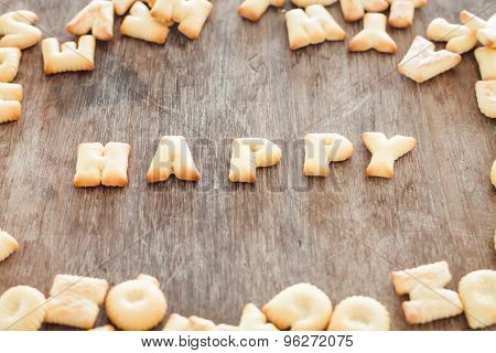 Happy Alphabet Biscuit On Wooden Table