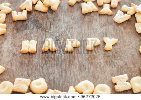 Happy Alphabet Biscuit On Wooden Table