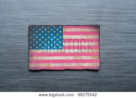 grungy American flag on brushed metal texture background