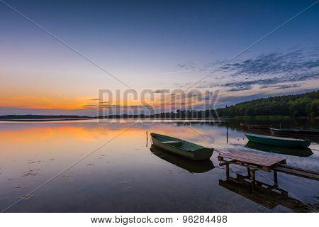 Beautiful Lake Sunset With Fisherman Boat