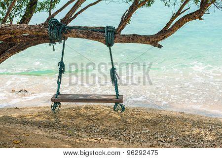 Wood Swing On The Beach