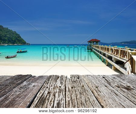Beautiful beach and old wooden pier at Perhentian islands, Malaysia