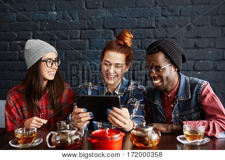 People, Modern Technology, Communication And Leisure Concept. Three Young Stylish People Of Differen