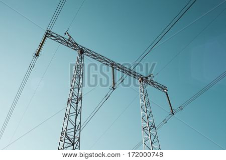 Tower high voltage against the clear sky