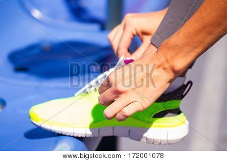 Young Woman Runner Tying Shoelaces, Summer Sport. Outdoor