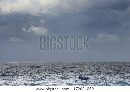 threatening sea with wind and boats swaying